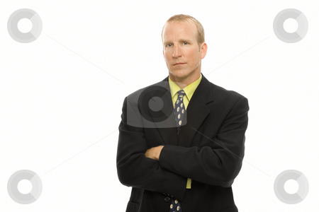 Businessman stands with arms crossed stock photo, Businessman in a suit stands with arms crossed by Rick Becker-Leckrone