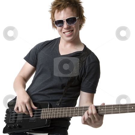 Rocking dude with electric bass guitar stock photo, A Rocking dude with an electric bass guitar by Rick Becker-Leckrone