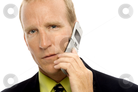 Businessman with cell phone stock photo, Businessman in a suit talks of cellular phone by Rick Becker-Leckrone