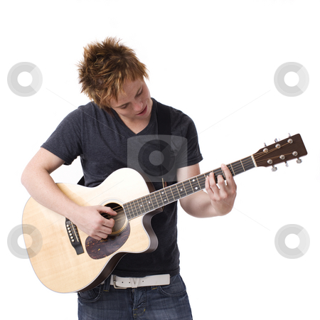 Boy plays guitar stock photo, A boy plays his guitar by Rick Becker-Leckrone