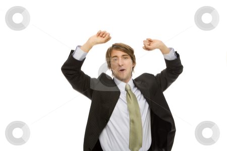 Businessman gestures success stock photo, Businessman in a suit gestures triumph with his arms by Rick Becker-Leckrone