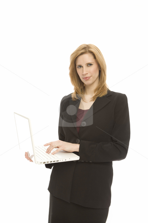 Businesswoman with laptop stock photo, A businesswoman holds and uses a laptop by Rick Becker-Leckrone