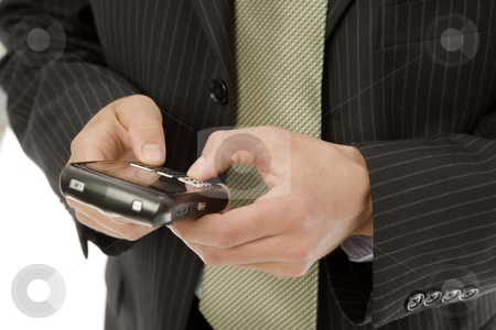 Businessman texts on mobile device stock photo, Businessman uses his thumbs to text on a mobile device by Rick Becker-Leckrone