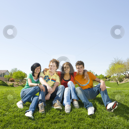 Four kids in a park stock photo, Four kids hang out in a park by Rick Becker-Leckrone