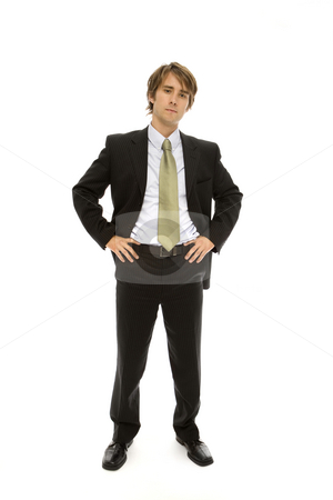 Businessman stands with confidence stock photo, Businessman in suit stands with confidence by Rick Becker-Leckrone
