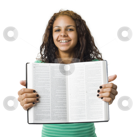 Girl holds bible stock photo, Girl holds bible open by Rick Becker-Leckrone