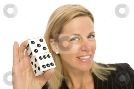 Blonde woman with dice stock photo, A blonde woman hold up a large pair of dice by Rick Becker-Leckrone