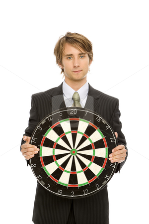 Businessman with target stock photo, Businessman in a suit holds up a target by Rick Becker-Leckrone