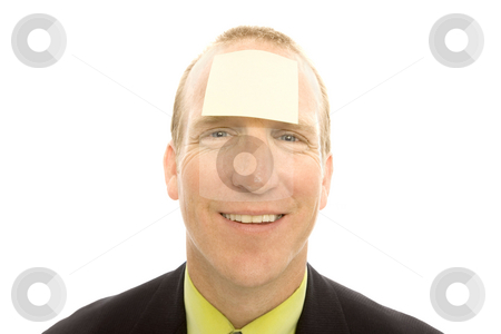 Businessman with note stock photo, Businessman in a suit with a note stuck to his head by Rick Becker-Leckrone
