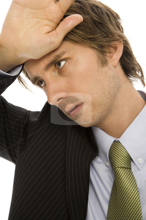 Businessman with stress stock photo, Businessman holds his hand to his head in pain by Rick Becker-Leckrone