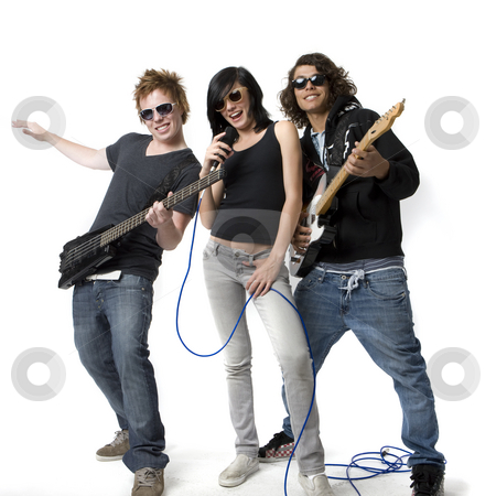 Band rocks out stock photo, Three bandmates sing and play guitar by Rick Becker-Leckrone