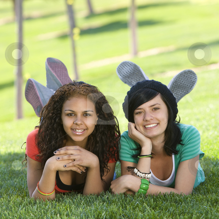 Girlfriends hang out in grass