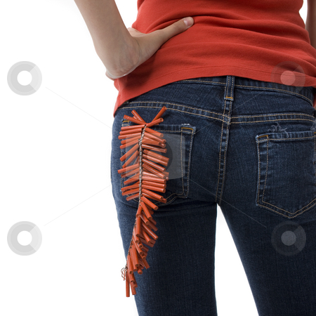 Girl with firecrackers stock photo, A girl with firecrackers in her back pocket by Rick Becker-Leckrone
