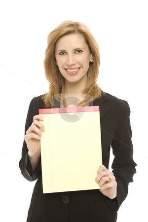 Businesswoman with pad of paper stock photo, A businesswoman in a suit holds a yellow pad of legal paper by Rick Becker-Leckrone