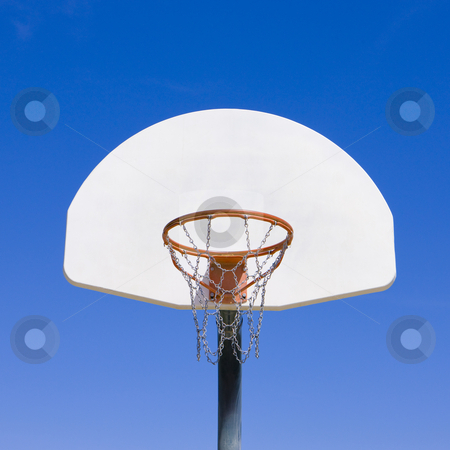 Basketball backboard stock photo, A simple view of a basketball backboard and hoop by Rick Becker-Leckrone