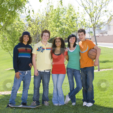 Teens hang out at park stock photo, Five teens hang out at park by Rick Becker-Leckrone