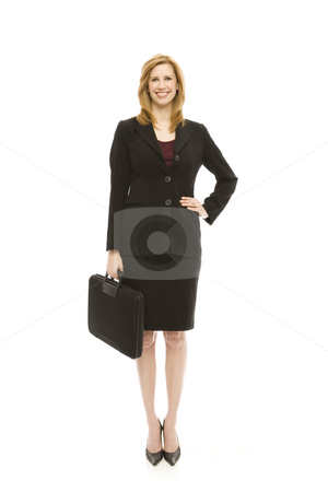 Businesswoman with briefcase stock photo, Businesswoman in a suit holds a briefcase by Rick Becker-Leckrone