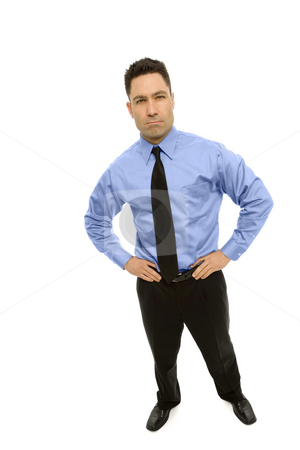 Businessman stands in a suit stock photo, Businessman stands wearing a business suit by Rick Becker-Leckrone