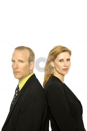 Business people stand together stock photo, Two business people stand back to back by Rick Becker-Leckrone