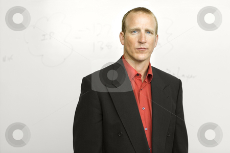 Businessman with writing board stock photo, Businessman stands confidently in front of writing board by Rick Becker-Leckrone