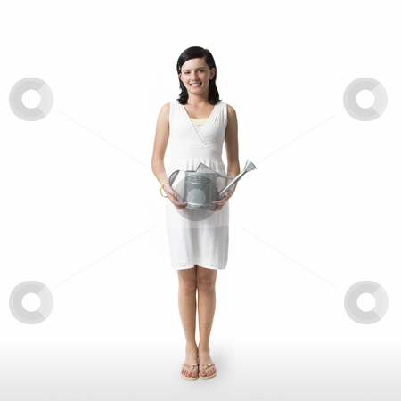 Girl with watering can stock photo, A girl with a watering can against a white background by Rick Becker-Leckrone