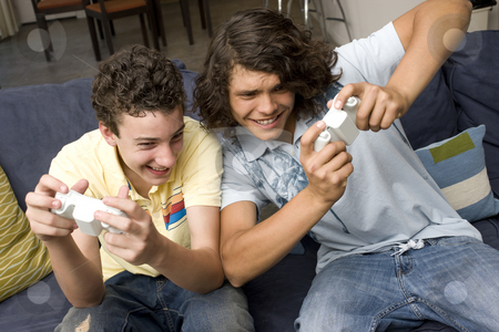 Two guys play videogames stock photo, Two guys play videogames on a couch by Rick Becker-Leckrone