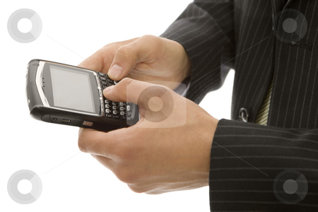 Businessman texts on phone stock photo, Businessman uses his thumbs with a mobile device by Rick Becker-Leckrone