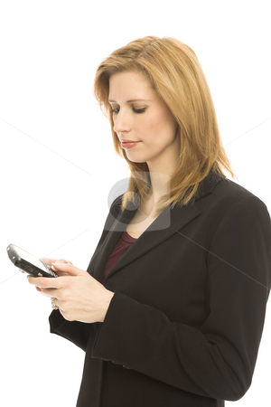 Businesswoman texts on mobile device stock photo, Businesswoman texts with her thumbs on a mobile device by Rick Becker-Leckrone