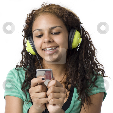 Teen with headphones stock photo, Teenage girl with headphones and media player by Rick Becker-Leckrone