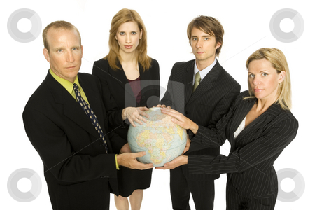 Business people hold a globe stock photo, Four business people hold a globe together by Rick Becker-Leckrone