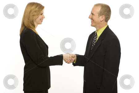 Business people shake hands stock photo, Two business people shake hands by Rick Becker-Leckrone