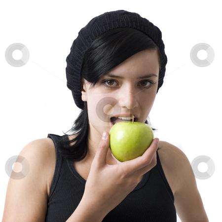 Girl eats an apple stock photo, A girl eats a green apple by Rick Becker-Leckrone