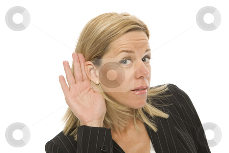 Businesswoman tries to listen stock photo, Businesswoman in a suit gestures with her hand to her ear to hear by Rick Becker-Leckrone