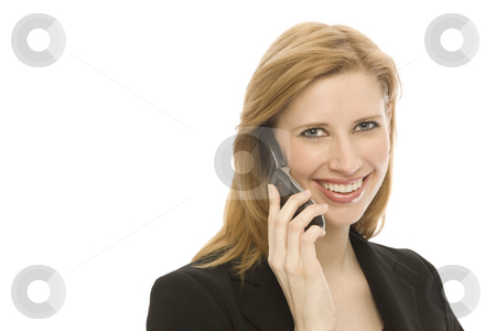 Businesswoman uses cell phone stock photo, A businesswoman in a suit uses a cell phone by Rick Becker-Leckrone