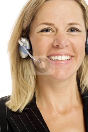Businesswoman with headset stock photo, Businesswoman with headset smiles against a white background by Rick Becker-Leckrone