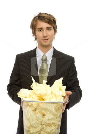 Businessman with waste paper basket stock photo, Businessman in suit holds a waste paper basket by Rick Becker-Leckrone