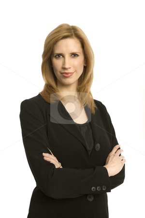 Businesswoman stands with confidence stock photo, Businesswoman in a suit stands with confidence by Rick Becker-Leckrone