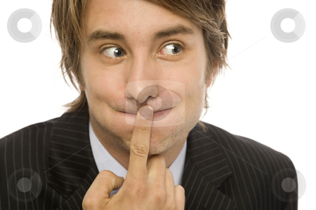 Businessman keeps a secert stock photo, Businessman holds his finger to his lips to keep a secret by Rick Becker-Leckrone