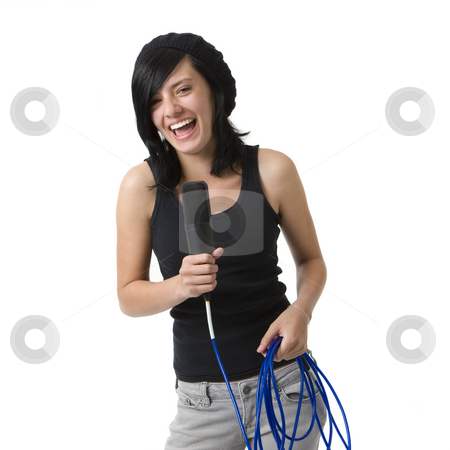 Girl with mic smiles and sings stock photo, A girl with a mic smiles and sings by Rick Becker-Leckrone