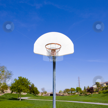 Basketball hoop in park stock photo, Basketball hoop in a green park by Rick Becker-Leckrone