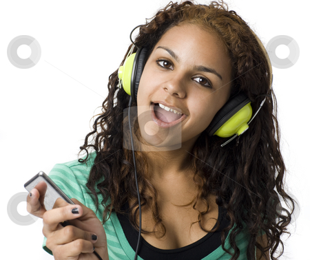 Girl listens with headphones stock photo, A girl sings and listens to headphones by Rick Becker-Leckrone