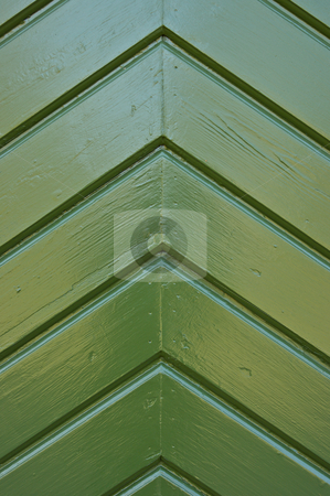 Green Door stock photo, A wooden pattern on a door, painted green. by Peter Soderstrom