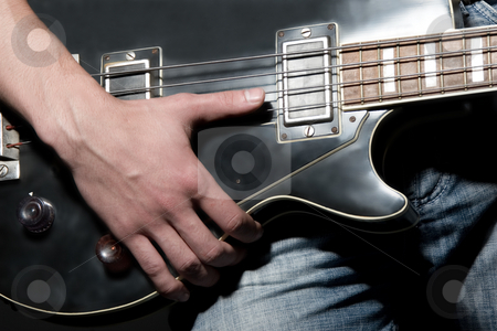 Vintage bass guitar stock photo, Vintage bass guitar by Andrey Butenko