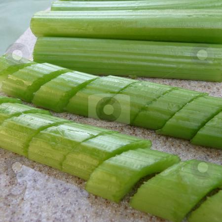 Fresh sliced and chopped celery stock photo, Fresh sliced and chopped celery on cutting board by Jill Reid