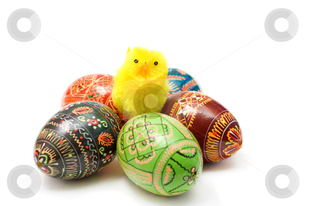 Easter theme stock photo, Funny toy chicken among colorful Easter eggs isolated on white by Natalia Macheda