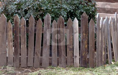 Weathered wooden picket fence corner stock photo, Wooden picket fence corner weathered by time by Jill Reid