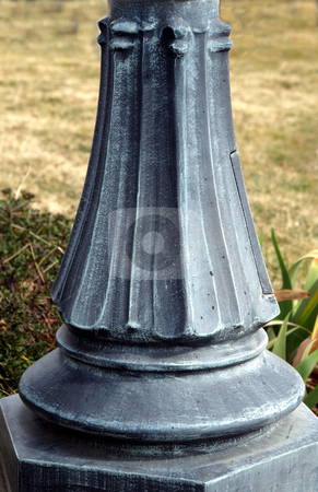 Metal lamppost base stock photo, Close-up of weathered metal lamppost base by Jill Reid