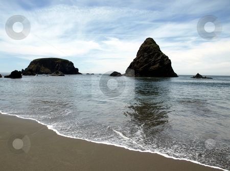 Oregon coastline stock photo, Rock outcroppings and a gentle surf on the beach in Oregon by Jill Reid