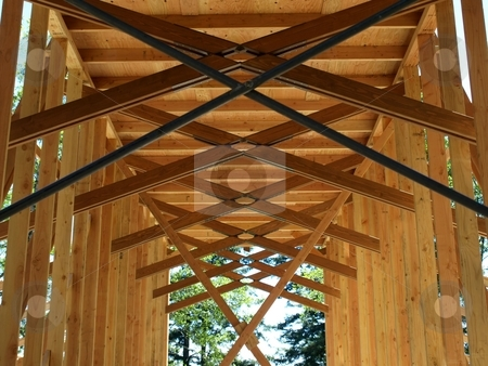 Open roofing trusses on new construction project 873A stock photo, Roofing trusses in progress on new construction project by Jill Reid