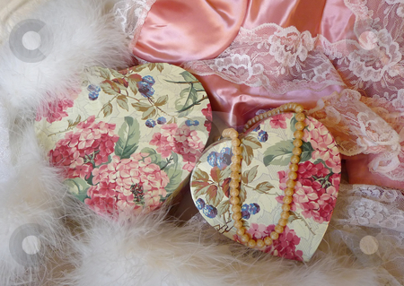 Pink satin lingerie and pearls stock photo, Romantic setting of pink and lace satin lingerie, strand of pearls and pink floral hearts by Jill Reid